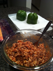 Stuffing peppers.
